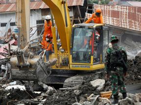 Search teams look for victims in the earthquake and liquefaction affected Balaroa neighbourhood in Palu, Central Sulawesi, Indonesia