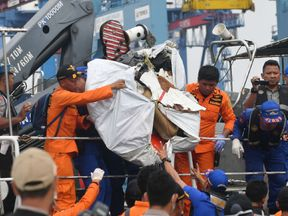 Debris from the ill-fated Lion Air flight JT 610 at a port in northern Jakarta