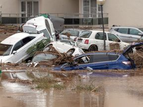 Vehicles destroyed by flash floods near of Sant Llorenc, in Mallorca island, eastern Spain