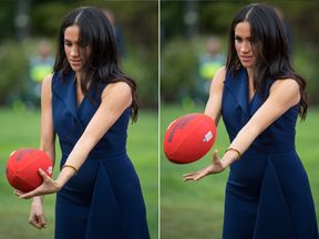 Meghan handballs an Australian Rules football while watching a demonstration of sporting activities organised by the This Girl Can campaign in Melbourne