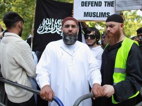 Anjem Choudary (C) leads a protest against the killing of Osama bin Laden