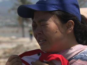 Fitria recalls the moment the tsunami struck her and her missing husband on a beach in Palu