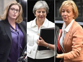 Theresa May and 'resignation-watch' ministers Penny Mordaunt (left) and Andrea Leadsom in Downing Street on Tuesday