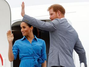 Prince Harry and Meghan Markle board their plane in Tonga to head to Sydney