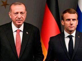 (From L) Russian President Vladimir Putin, German Chancellor Angela Merkel, Turkish President Recep Tayyip Erdogan and French President Emmanuel Macron