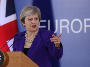 Theresa May speaks to the media following the October EU summit