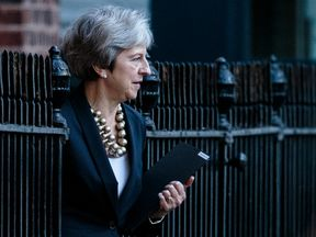 Theresa May leaves the back of Number 10 Downing Street
