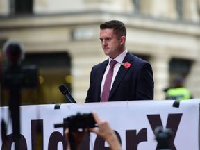 Tommy Robinson addresses his supporters as he arrives at the Old Bailey