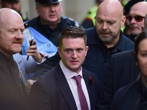 Tommy Robinson leaving the Old Bailey, London where Judge Hilliard said his case should go to the Attorney General for his consideration after receiving a statement from Robinson on Monday. PRESS ASSOCIATION Photo. Picture date: Tuesday October 23, 2018. The Former English Defence League (EDL) leader is alleged to have committed contempt of court by filming people in a criminal trial and broadcasting footage on social media.