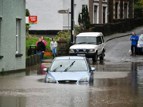 A car is stranded in floodwater in Tonna near Aberdulais in South Wales.