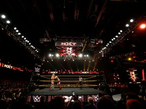 WWE wrestler Bin Wang of China is deadlocked by opponent Wesley Blake during a taping of the WWE's NXT show at Full Sail University in Winter Park, Florida, November 30, 2016