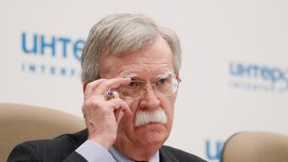 U.S. National Security Adviser John Bolton adjusts glasses during a news conference in Moscow, Russia October 23, 2018.