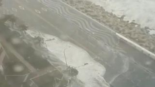 Waves are driven inland by a typhoon in South Korea
