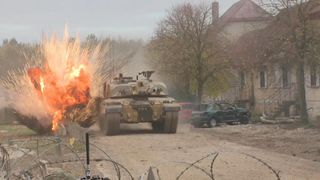 The British army will allow women to apply for all roles, said the defence secretary during an urban ops demo on Salisbury plain.