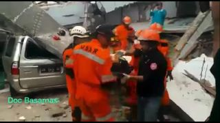 Rescue workers pulled survivors from the rubble in the provincial capital Palu on September 30, after a magnitude-7.4 earthquake and tsunami struck Indonesia's Central Sulawesi province on September 28, killing at least 832 people.