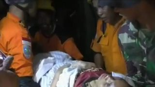 Woman pulled alive from earthquake rubble