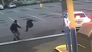 CCTV shows man attacking couple in car and then chased away by two strangers