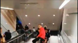 Hail and rain swamps an escalator in Rome