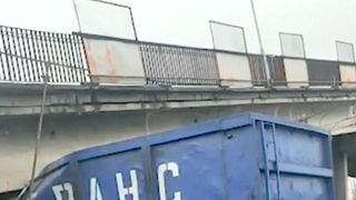 Motorway collapses on to section of trans-Siberian railway