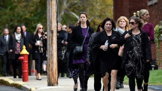Mourners arrive for a combined funeral for eight victims, including four sisters and two brothers, from last Saturday's limousine crash at St. Stanislaus Roman Catholic Church in Amsterdam, New York, U.S