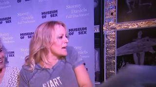 Stormy Daniels' reaction to a chair being removed at a book signing