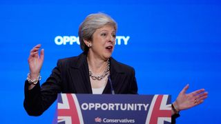 "British Prime Minister Theresa May delivers her leader's speech during the final day of the Conservative Party Conference at The International Convention Centre on October 3, 2018 in Birmingham, England. Theresa May delivered her leader's speech to the 2018 Conservative Party Conference today. Appealing to the ""decent, moderate and patriotic"", she stated that the Conservative Party is for everyone who is willing to ""work hard and do their best"". This year's conference took place six months before the UK is due to leave the European Union, with divisions on how Brexit should be implemented apparent throughout."