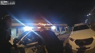 Newly released body cam footage shows the woman stealing a police car moments after being handcuffed in the back seat.