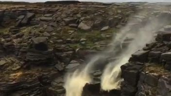 High winds create the impression that part of the Kinder Downfall in the Peak District is somehow flowing backwards