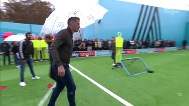 Carragher's volley with a brolly!
