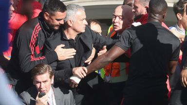 Jose held back after touchline tussle