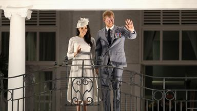 Britain's Prince Harry and Meghan, Duchess of Sussex wave from the balcony of the Grand Pacific Hotel in Suva, Fiji October 23, 2018. Chris Jackson/Pool via REUTERS