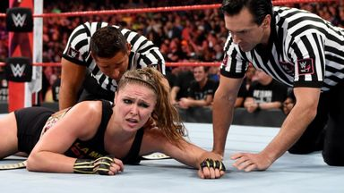 Natalya helps hurt Rousey leave arena