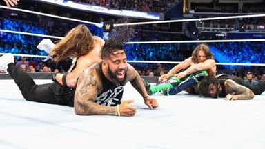 Bryan & AJ Styles take on the Usos