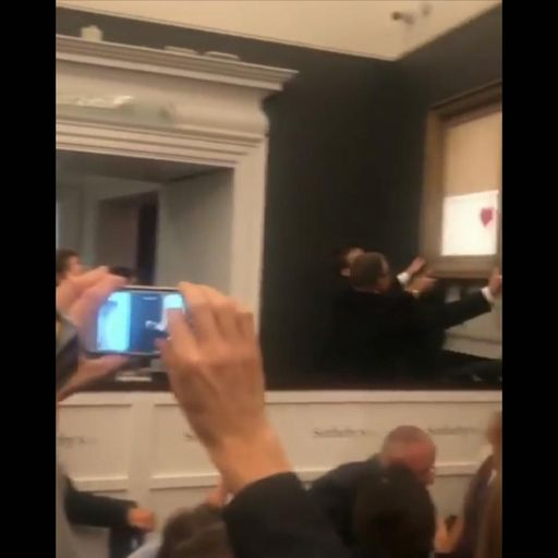 Who is the mystery man who filmed at Banksy auction?