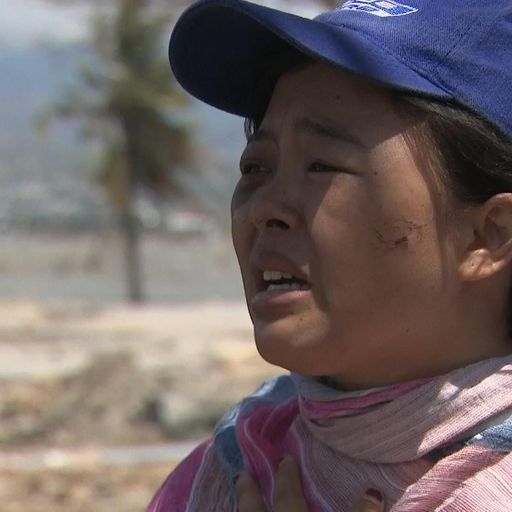 Grieving wife recalls moment she lost husband in quake-tsunami