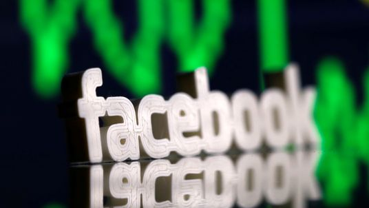 A 3D-printed Facebook logo is seen in front of displayed stock graph in this illustration photo March 20, 2018. Picture taken March 20