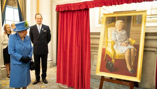 Queen Elizabeth II viewing a new portrait of her painted by BP Portrait Award 2017 winner, Benjamin Sullivan