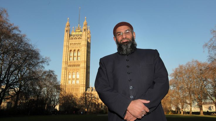Anjem Choudary posing in front of the Houses of Parliament