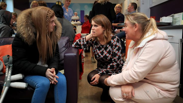 Eugenie visiting a 14 year old cancer patient during a visit to the Teenage Cancer Trust ward at Alder Hey Hospital