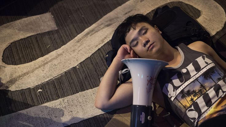 A pro-democracy protester sleeps in the street in the Mongkok district of Hong Kong on October 19, 2014
