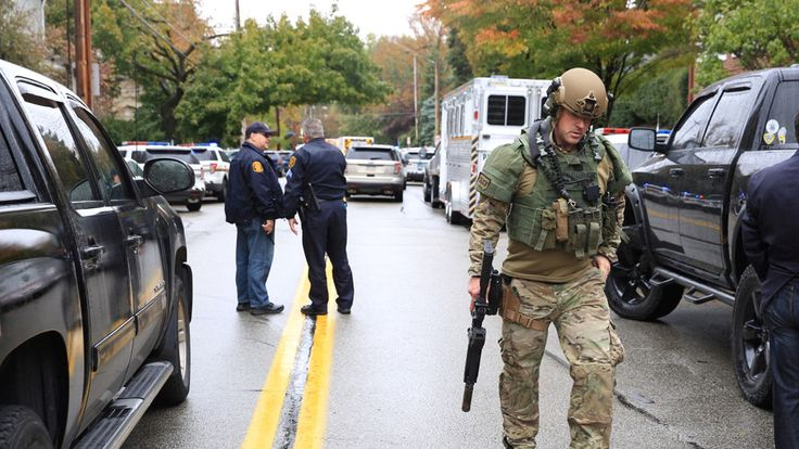 Police officers respond after a gunman opened fire at the Tree of Life synagogue in Pittsburgh Pennsylvania...
