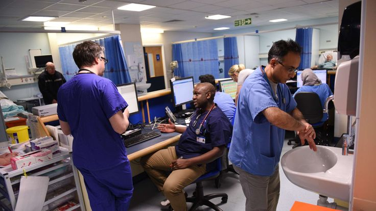 Members of clinical staff work at computers in the Accident and Emergency department of the 'Royal Albert Edward Infirmary' in Wigan, north west England on April 2, 2015
