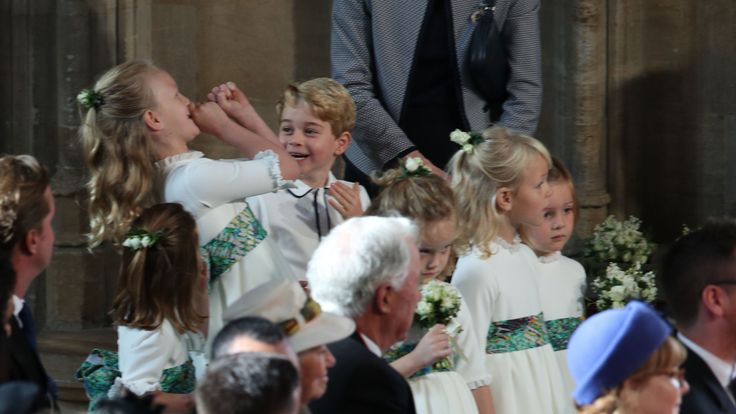 The bridesmaids and page boys, including Princess Charlotte of Cambridge (L), Savannah Phillips (2L) and Prince George of Cambridge (3L)
