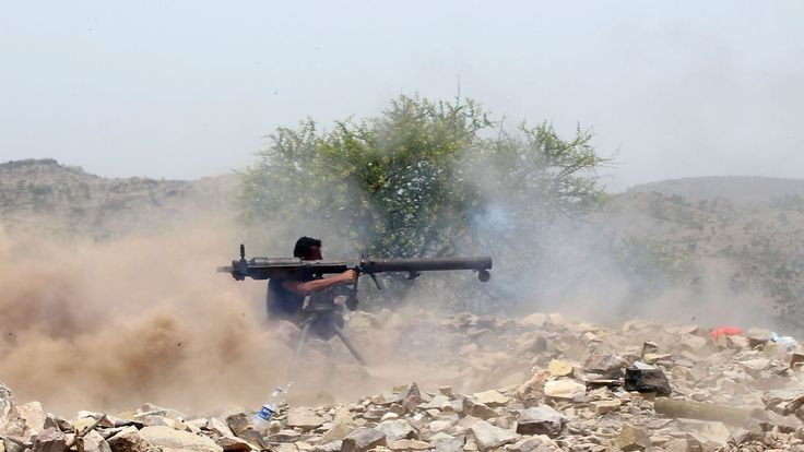 A Yemeni pro-government fighter with UAE-supported forces fires a rocket launcher on the frontline of Kirsh, southwestern Yemen