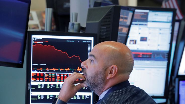A trader works on the floor of the New York Stock Exchange (NYSE) in Manhattan in New York