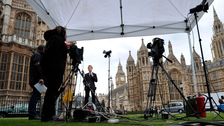 A television crew work in front of the British Houses of Parliament in Westminster, London on May 7, 2010