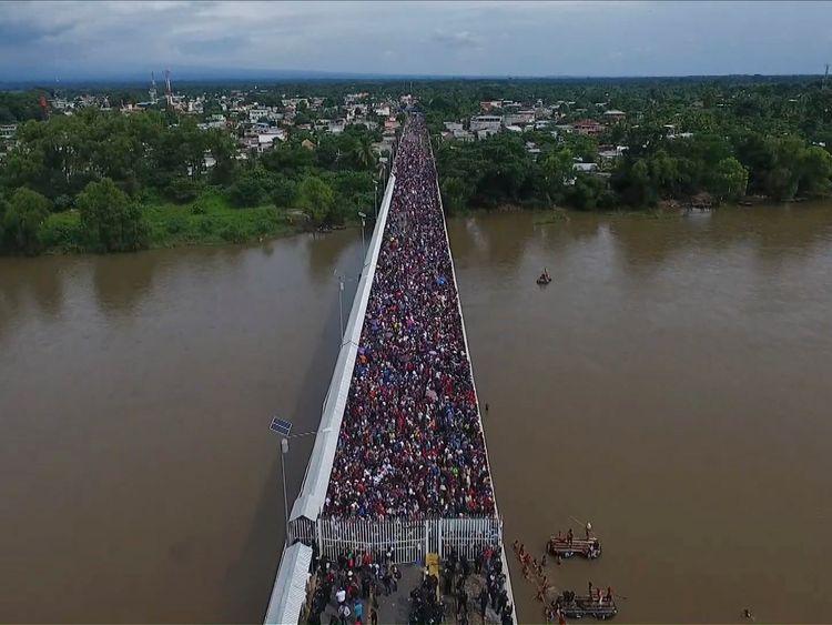 Honduran migrants gather at Guatemala's northern border with Mexico