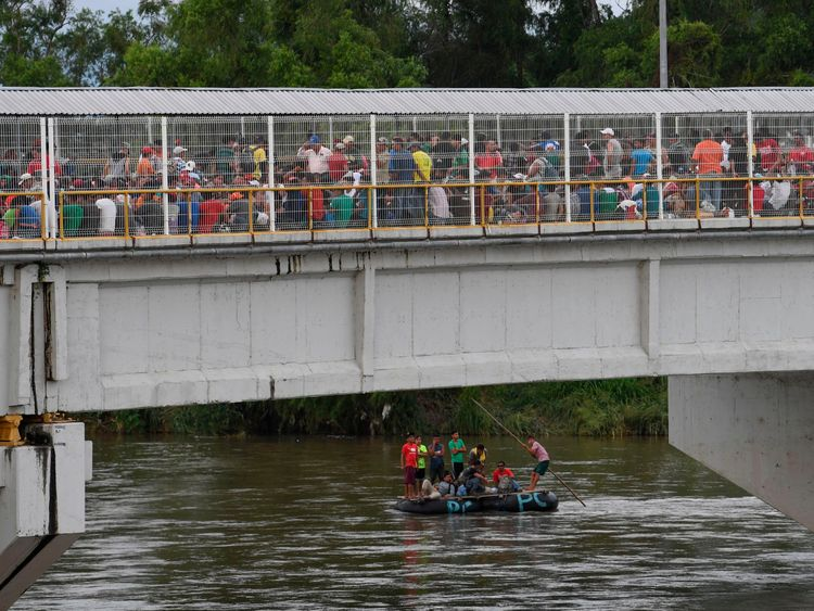Honduran migrants on a bridge approaching the Guatemala-Mexico border