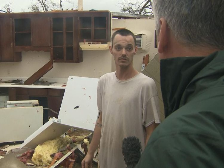 Aaron in his damaged apartment after Hurricane Michael