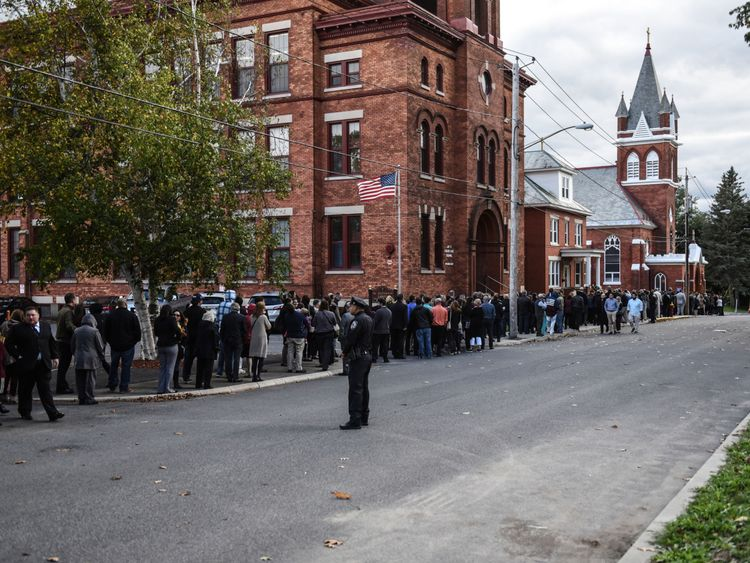 Mourners line up in front of St. Stanislaus Roman Catholic Church to pay their respects to some of the victims in last weekend's fatal limo crash on October 12, 2018 in Amsterdam, New York